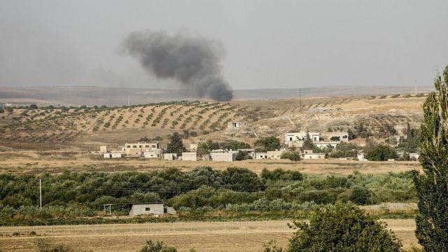 Дым над сирийским городом у границ с Турцией