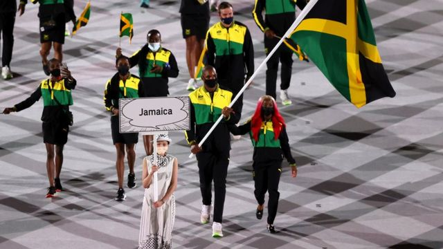 Flag bearers Shelly-Ann Fraser-Pryce and Ricardo Brown of Team Jamaica leads their team in during the Opening Ceremony of the Tokyo 2020 Olympic Games at Olympic Stadium on July 23, 2021 in Tokyo, Japan.