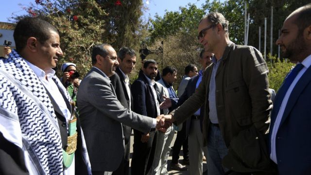 Retired Dutch general Patrick Cammaert (2nd-R), who heads a United Nations team tasked with monitoring a ceasefire between the Iranian-aligned Houthi group and Saudi-backed government forces in Yemen's Hodeidah, greets officials upon his arrival in the Yemeni capital Sanaa on December 23, 2018.