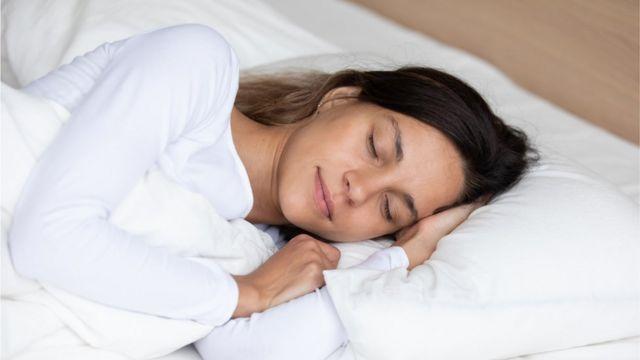 A woman sleeping on a foam mattress (stock photo)