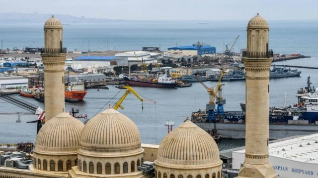 The Bibi Heybat Mosque in front of an oil field on the Caspian Sea coast, outside Baku, on March 19, 2019.
