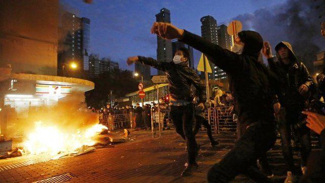 Rioters throw bricks at police