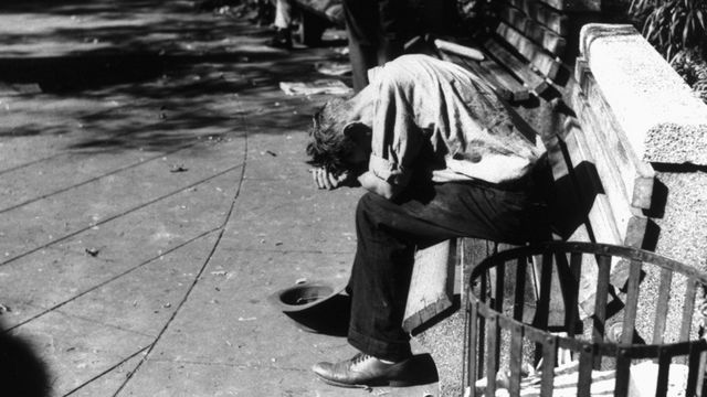 A beggar during the Great Depression in America