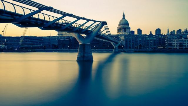 View of London, looking across the Thames, from the Millennium bridge to St Paul's Cathedral