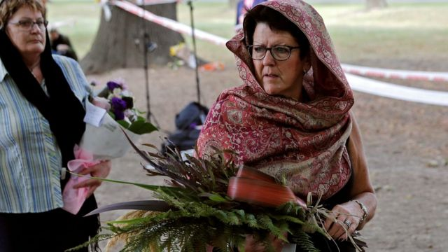 Women wearing headscarves are seen at Hagley Park outside Al-Noor mosque in Christchurch, New Zealand, March 22, 2019
