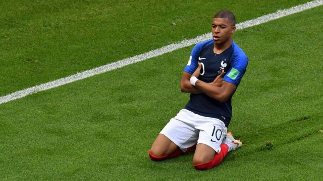 "France""s Kylian Mbappe celebrates after scoring his team""s third goal during the Russia 2018 World Cup round of 16 football match between France and Argentina at the Kazan Arena in Kazan on June 30, 2018."