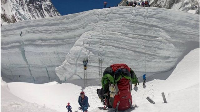 Mountaineers close to Camp 2 prepare to ascend steep ladders towards Camp 3