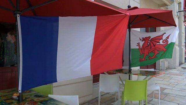 French flag alongside Welsh flag