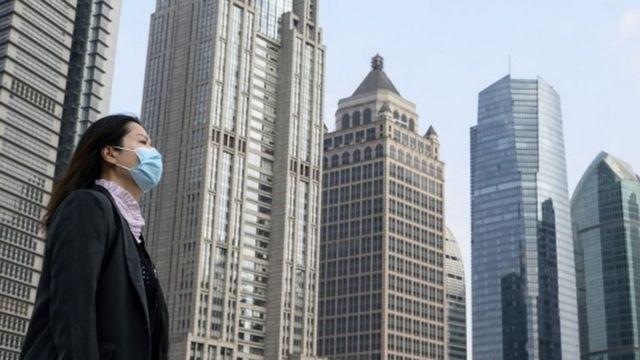 Woman wears a mask in Shanghai