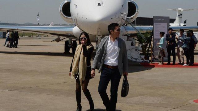 Chineses em aeroporto