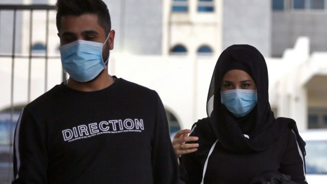 people in masks in Beirut