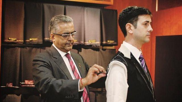 Raja Daswani measuring customer for suit