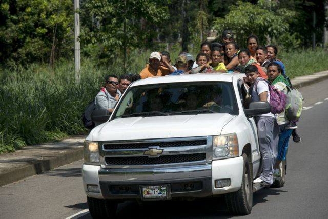 Private cars transport migrants from the Guatemala-Mexico border to the city of Tapachula 40km away