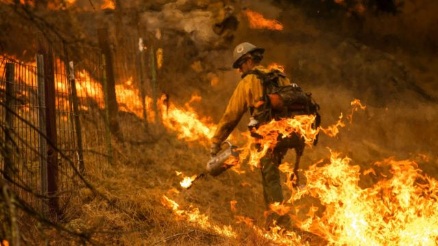 A firefighter battles the Kincade Fire in California on 26 October, 2019
