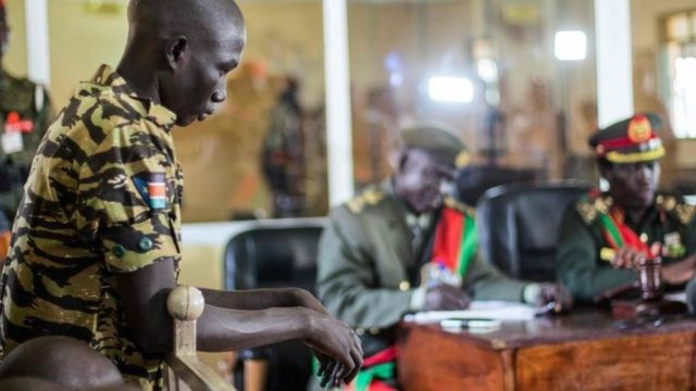 A South Sudanese soldier listens his verdict at the military court in Juba, South Sudan, on September 6, 2018