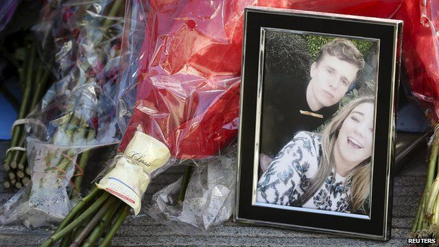 Flowers and a framed photograph at the scene of balcony collapse in Berkeley California