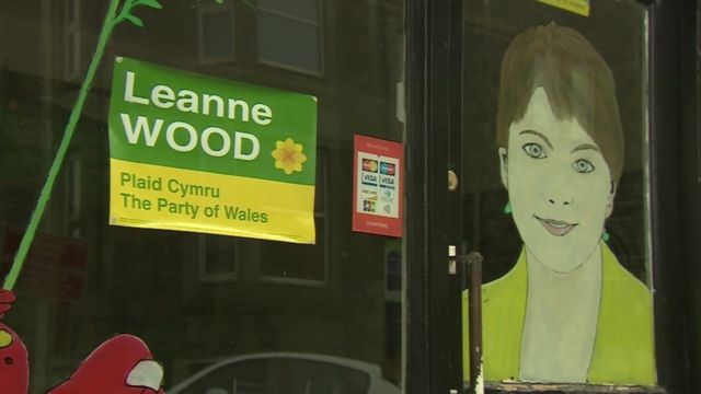 Plaid Cymru election poster and picture of candidate Leanne Wood on shop window