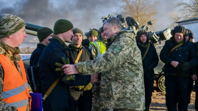 President Petro Poroshenko talking with tank crews during drills near the city of Chernihiv, northern Ukraine. 28 Nov 2018
