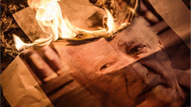 Image of Fethullah Gulen which has been set on fire