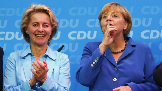 German Labour Minister Ursula von der Leyen (L) and German Chancellor and leader of the Christian Democratic Union (CDU)
