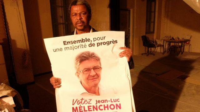 France. Saïd, colleur d'affiches de Jean-Luc Mélenchon dans le 20eme arrondissement, avril 2017