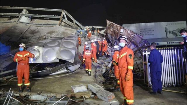 Rescuers work at the site of a collapsed five-story hotel building in Quanzhou city in southeast China's Fujian province, 07 March 2020.