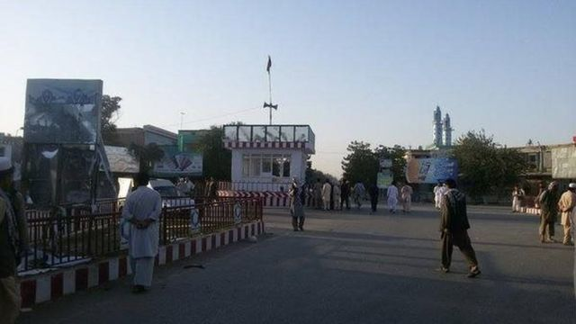A roundabout, with the Afghan flag flying in the middle