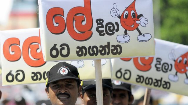 Sri Lankan volunteers carry placards encouraging blood donations during a march in Colombo on June 14, 2009, held to mark World Blood Donation Day. Hundreds of activists took part in the march in a country where many volunteered to donate blood during heavy fighting between troops and Tamil Tigers that ended in May after nearly four-decades of ethnic bloodshed.