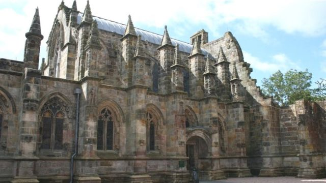 Rosslyn Chapel remains reburied in church grounds