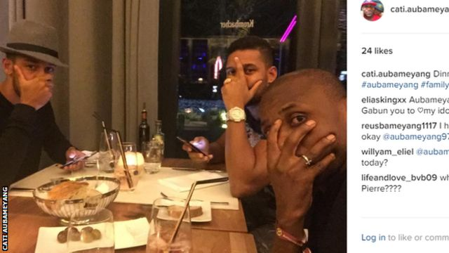 Pierre-Emerick Aubameyang (left) was pictured at a restaurant with his brother before kick-off
