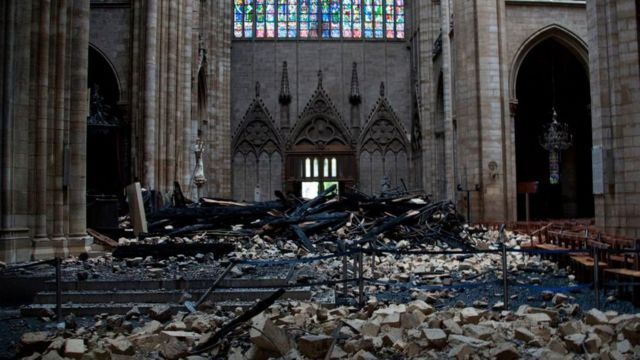 Debris on the floor of Notre-Dame cathedral after a fire tore through the building, April 2019