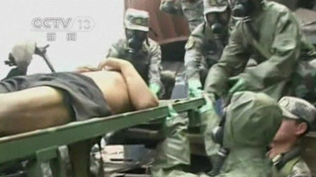 Man being rescued from Tianjin blast site
