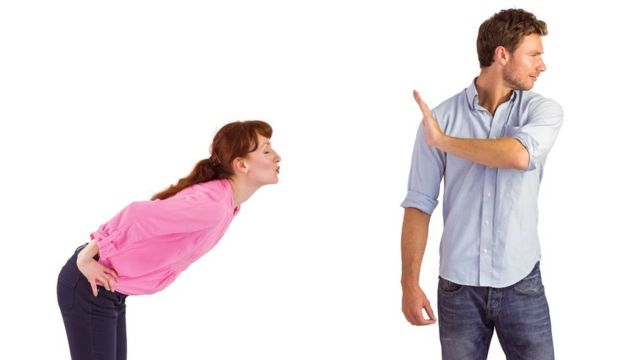 A woman propositions an unimpressed man