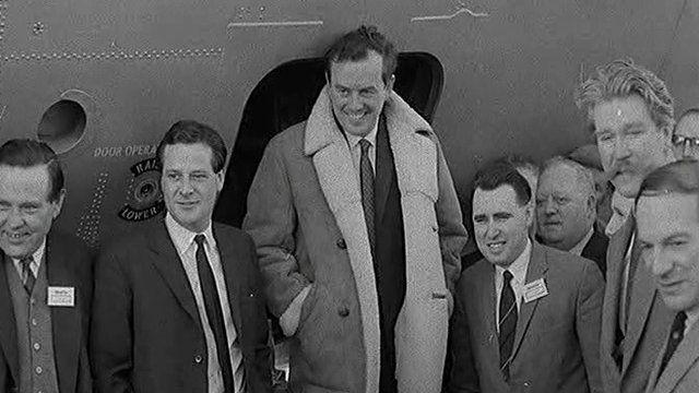 Northern Ireland dignitaries gather around as pilot Denis Taylor prepares for the plane's maiden voyage