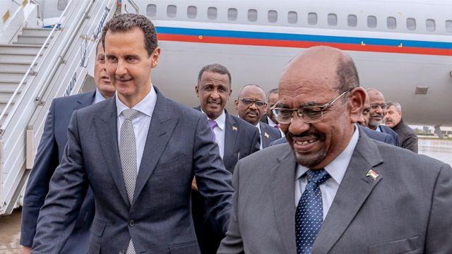 Omar al-Bashir (R) seen visiting President Assad in Syria in December 2018