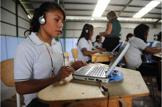 A Costa Rican studen of the Julio Fonseca Institute practices her language skills on her computer during the start of the pilot project 'Multilingual Costa Rica' in San Jose, on April 13, 2010. A total of 54 schools and 64 colleges across the country receive about 2,500 computers for students to learn the English language. AFP PHOTO/Yuri CORTEZ (Photo credit should read YURI CORTEZ/AFP/Getty Images)