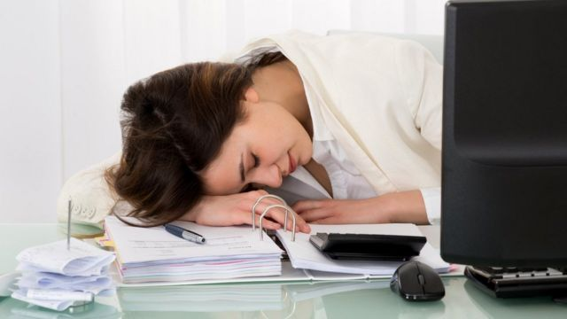 Businesswoman sleeping on desk