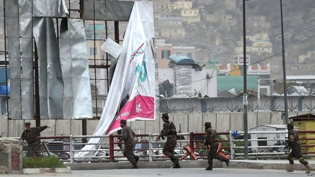 Afghan security personnel arrive at the scene after the blast