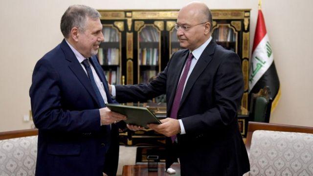 الرئيس العراقي برهم صالح ورئيس الوزراء المكلف توفيق علاوي