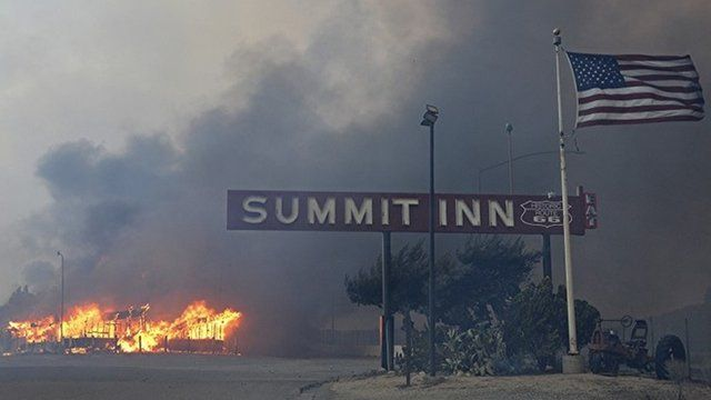 Summit Inn, a popular roadside diner at the crest of historic Route 66 in Oak Hills, Calif. burns to the ground after a fast burning wildfire swept through the town
