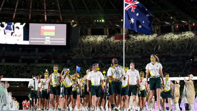 Flag bearers Cate Campbell and Patty Mills of Team Australia lead their team out during the Opening Ceremony of the Tokyo 2020 Olympic Games at Olympic Stadium on July 23, 2021 in Tokyo, Japan.