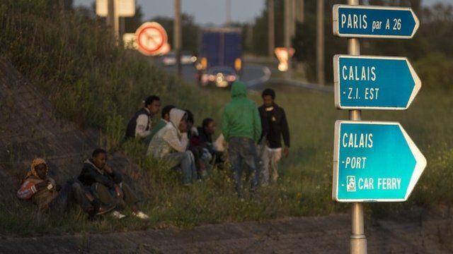 Migrants by the roadside in Paris