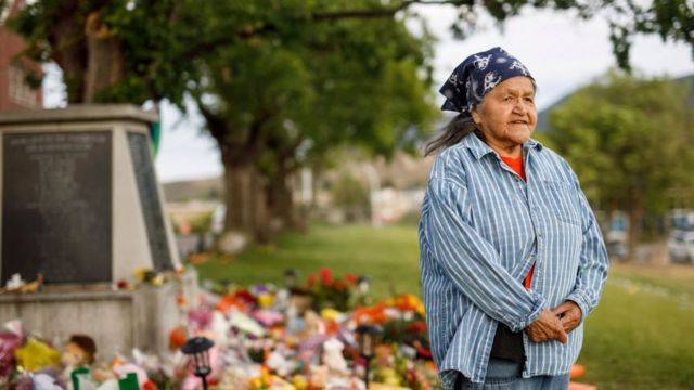 Evelyn Camille, survivor of the Kamloops school, next to the memorial in memory of the victims.