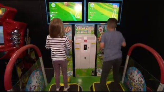 Children playing in an arcade