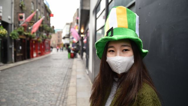 Person dressed for the party in Dublin.