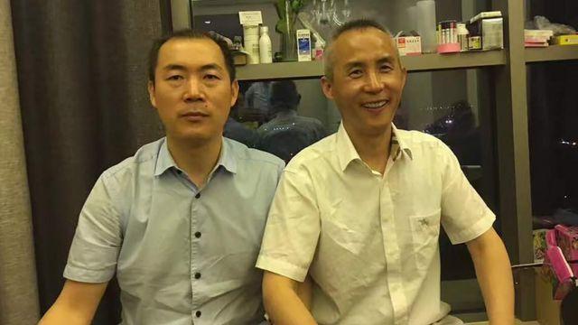 維權律師李和平(右)