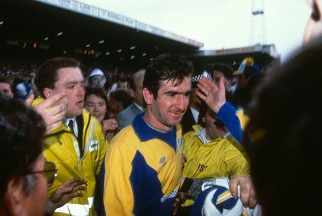 Eric Cantona is mobbed by Leeds United fans after their home game against Norwich City on 2 May 1992