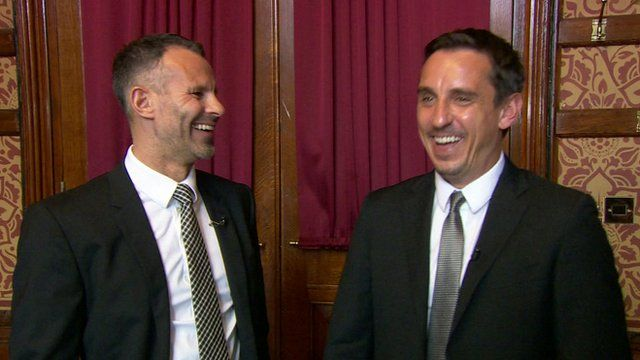 Ryan Giggs and Gary Neville laughing