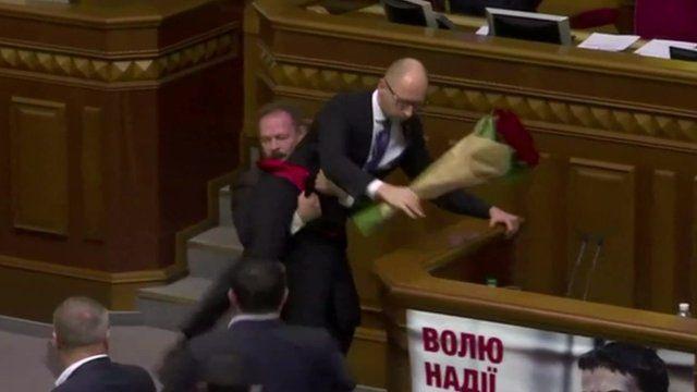Prime Minister Yatsenyuk is assaulted in the Ukrainian parliament