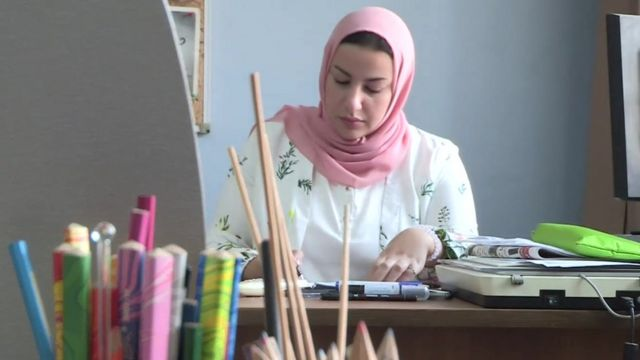 Doaa el-Adl, a cartoonist from Egypt, drawing in her office
